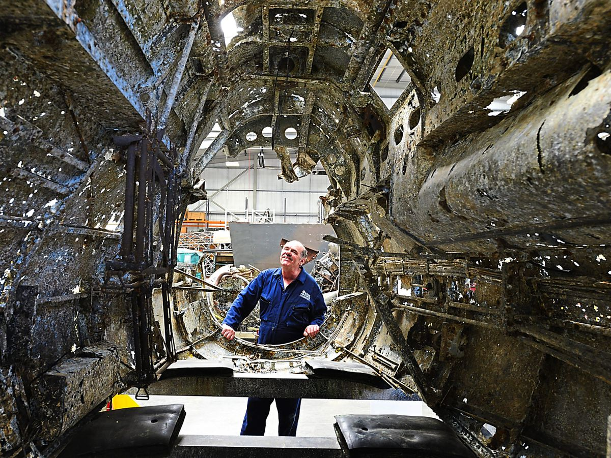 Aircraft technician John Warburton, from Telford, looks at the fuselage of the historic Dornier, which is now set to remain at RAF Cosford Museum