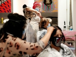 Masks and aprons in abundance as hair salon reopens at midnight post-lockdown