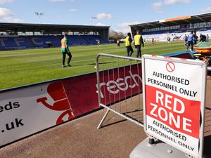 A social distance sign showing the Red Zone in an empty Montgomery Waters Meadow Stadium the home of Shrewsbury Town during the Coronavirus Covid19 pandemic.