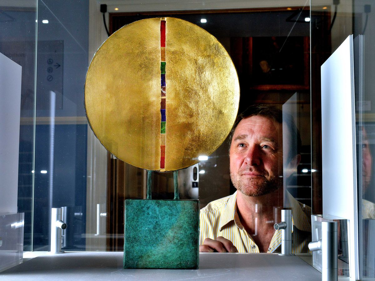 Paul Kennedy with the 1/5 version of the artwork on display at Shrewsbury Museum & Art Gallery.