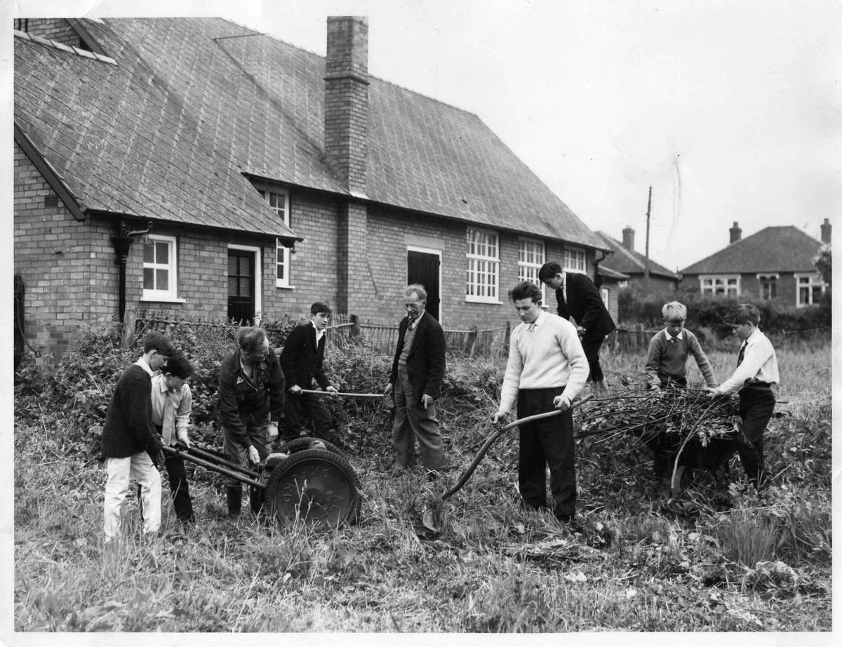 A 16-year-old Allan Caswell, centre with scythe, pictured working on the grounds of Bayston Hill Memorial Hall in 1960