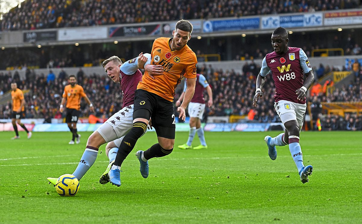 Wing-back Matt Doherty puts pressure on Villa's Matt Targett on Wolves' right flank