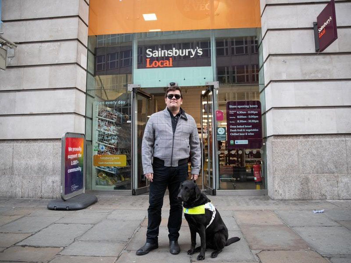 British Paralympic skiing champion John Dickinson-Lilley with his guide dog Brett