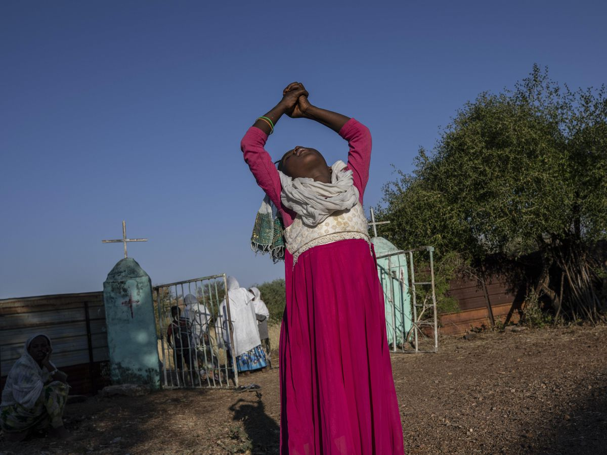 A Tigrayan woman who fled the conflict in Ethiopia's Tigray region at a refugee camp in Sudan