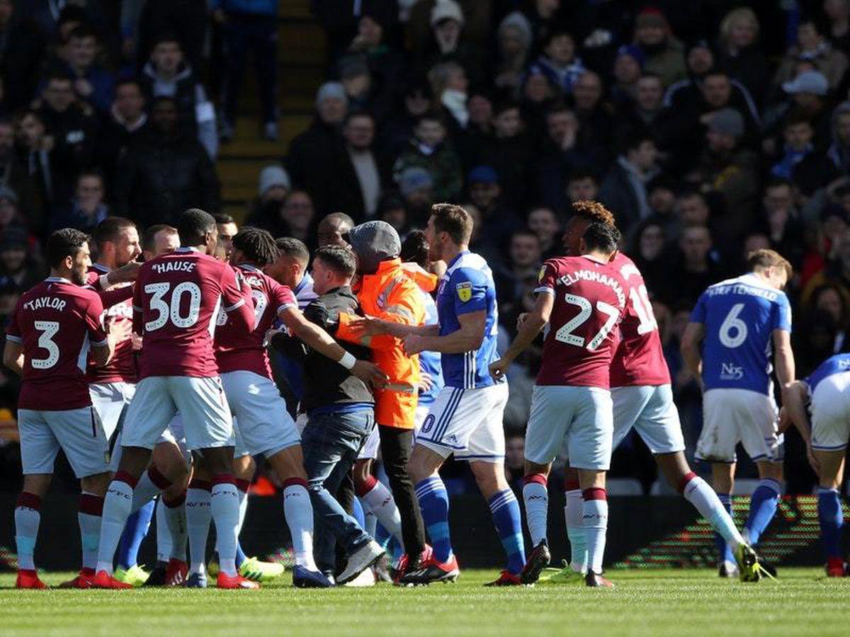 Paul Mitchell attacks Aston Villa's Jack Grealish on the pitch (Nick Potts/PA)