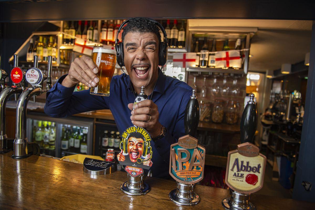Chris Kamara enjoying a pint of his own ale