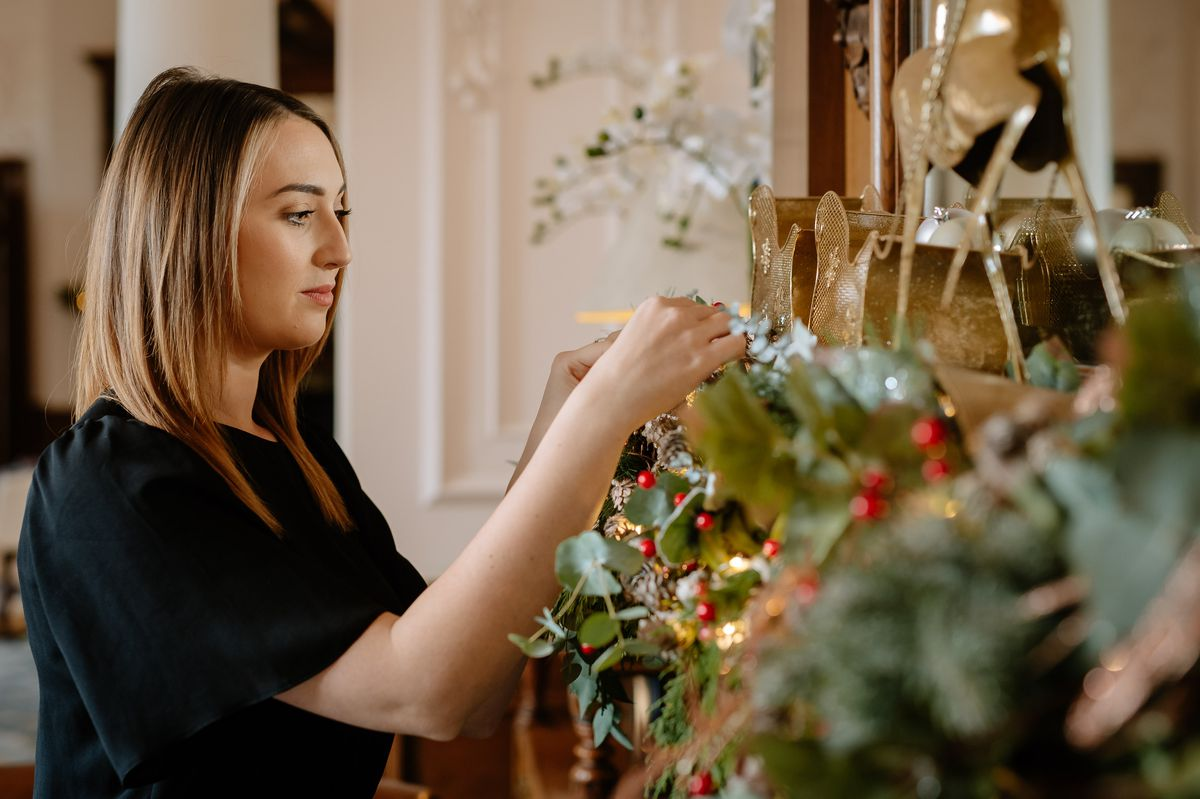 Laura puts the finishing touch on decorations at Hawkstone Hall
