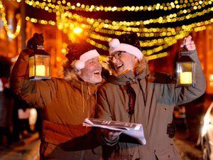 Alan Jones and Steve Rose enjoy singing Carols on the Doorstep in Benyon Street, Shrewsbury