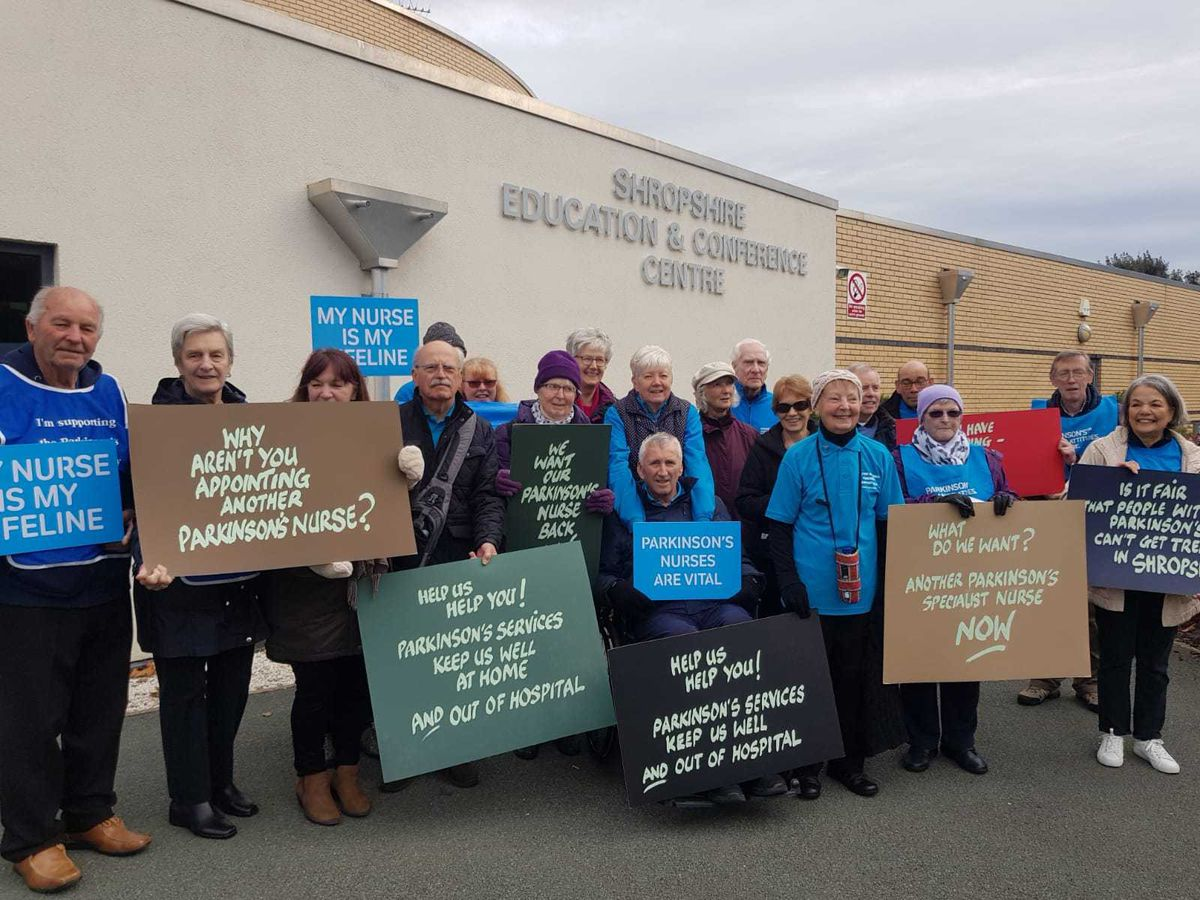 Campaigners gathered outside a public meeting of hospital bosses earlier this month