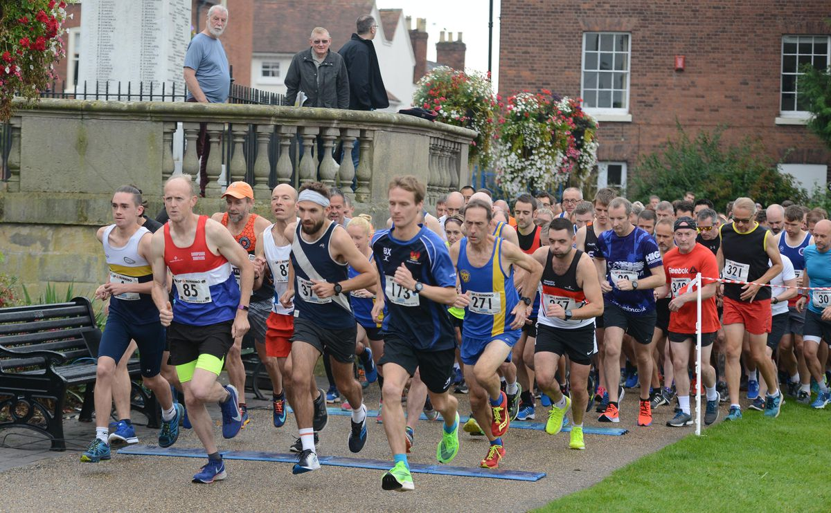 Philip Boak, front right, started the race strong and went on to finish first with a personal best time of 33:14