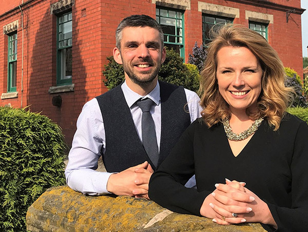 Aaron Dean and Christina Trevanion outside Trevanion and Dean Auctioneers in Whitchurch