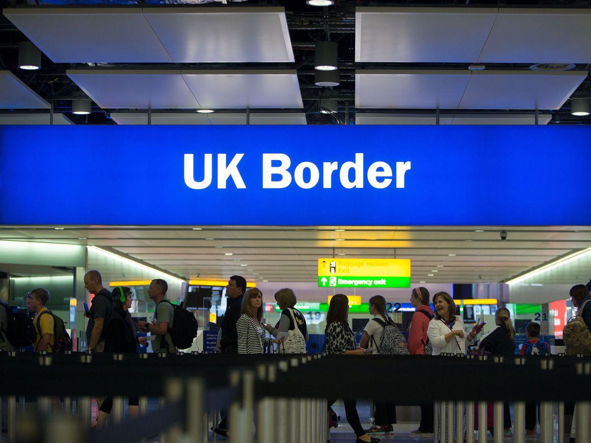Passengers pass through border checks at Heathrow