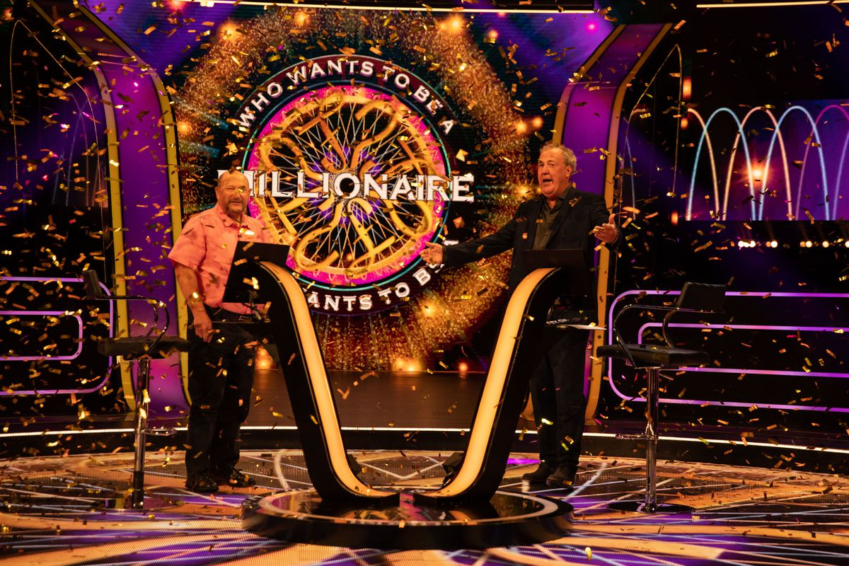Donald Fear, from Telford, celebrates his £1m jackpot win on Who Wants To Be A Millionaire? with show host Jeremy Clarkson, right