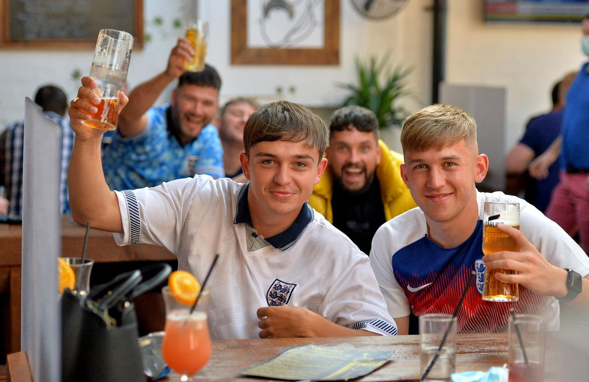 Pictured from left, James Gregory-Cork and Harvey Howell watching the game at the Salopian in Shrewsbury