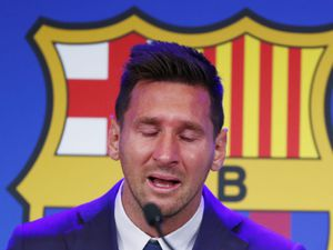 Lionel Messi speaks during a press conference at the Camp Nou stadium in Barcelona, Spain, Sunday, Aug. 8, 2021. FC Barcelona had previously announced the negotiations with Lionel Messi had ended and that Messi would be leaving the club. (AP Photo/Joan Monfort).