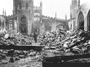 People picking through the ruins of Coventry Cathedral, which was destroyed 80 years ago today in devastating bombing raids