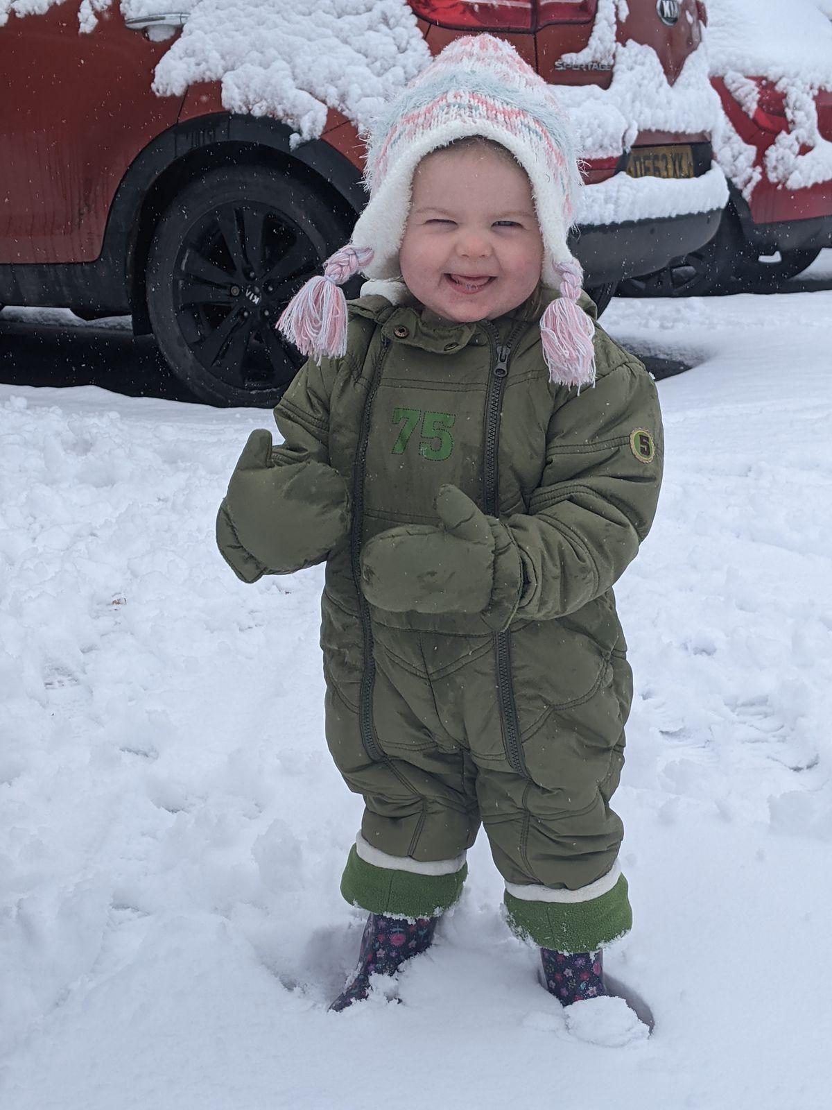 Grace Peter enjoying her first snow in Four Crosses, near Oswestry. Photo: Steve Peter