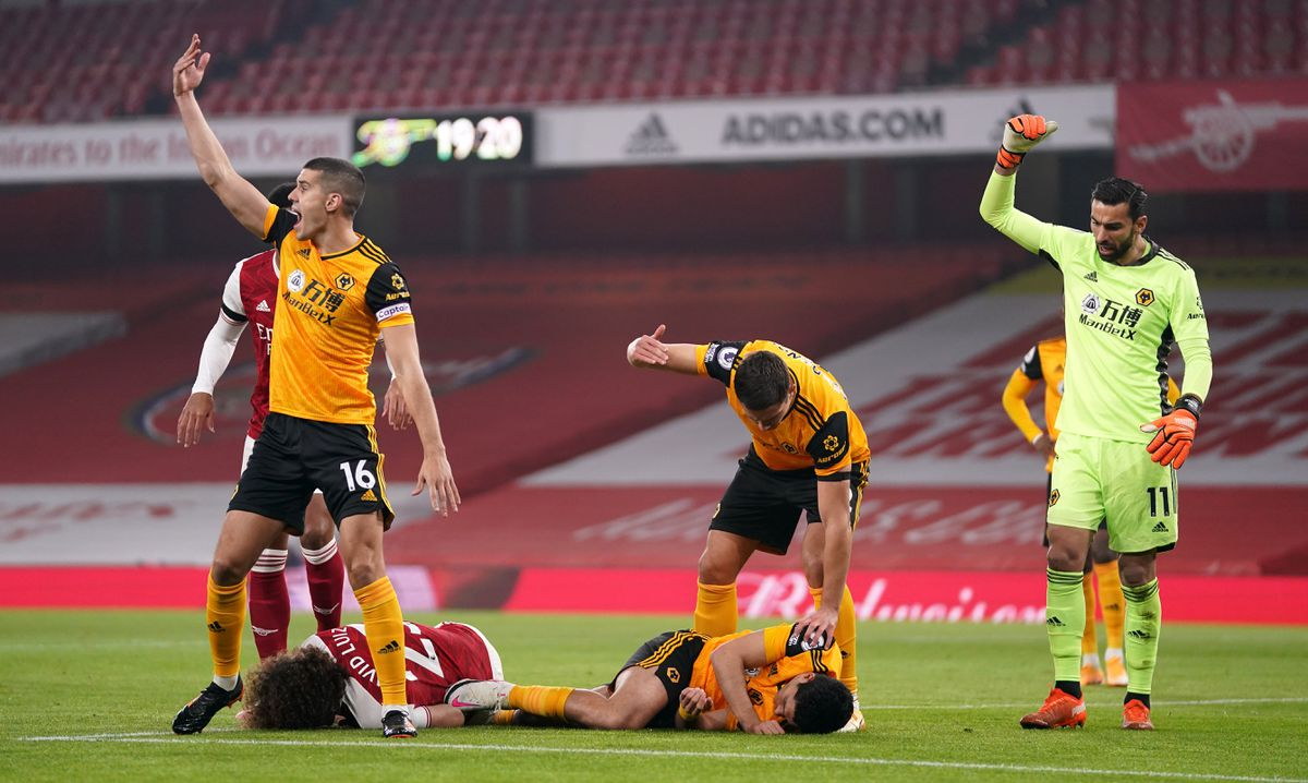 Players reacts after Arsenal's David Luiz (left, floor) clashes heads with Wolverhampton Wanderers' Raul Jimenez (right, floor) during the Premier League match at the Emirates Stadium, London..