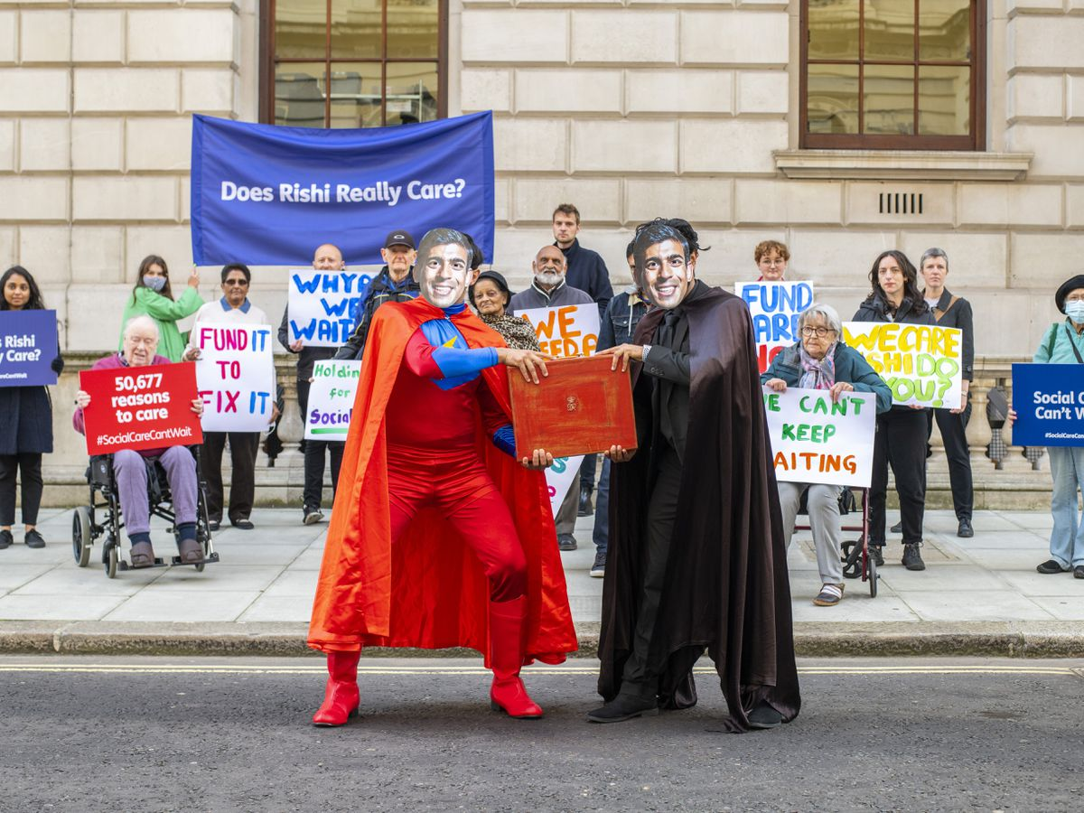 A protest by Age UK and other members of the Care Support Alliance outside the Treasury in London