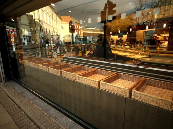 Empty baskets in a bakery (Tim Goode/PA)