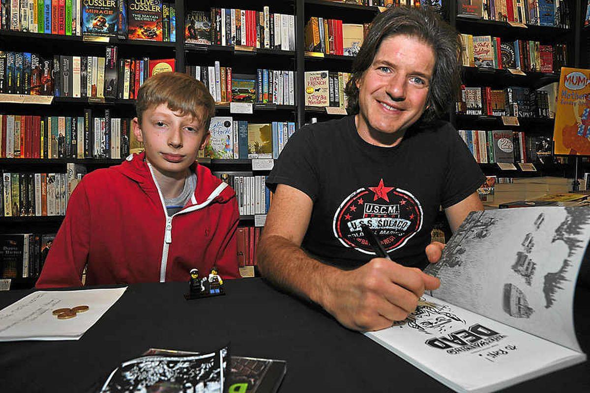 Charlie Adlard with Rhys Brown, from Wolverhampton