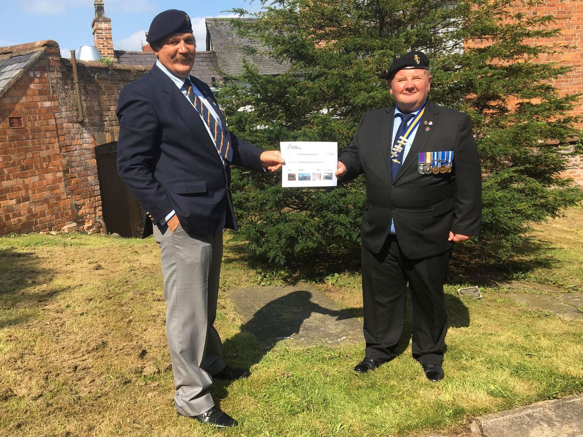 Ian Davies, left, presents a cheque to Ian Williams chairman of the Royal British Legion