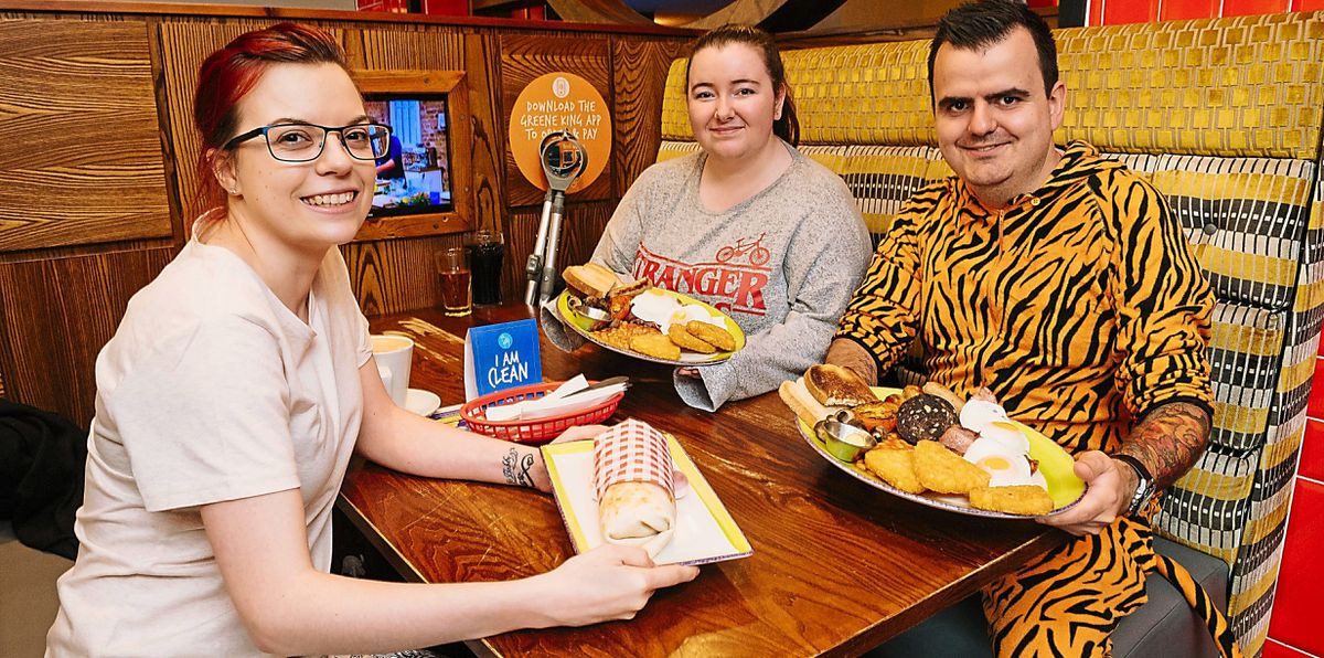 LAST COPYRIGHT SHROPSHIRE STAR JAMIE RICKETTS 12/06/2021 - Wrekin Giant pub in Southwater, Telford are offering free breakfast for people who turn up in Pyjamas. In Picture L>R: Jess Neail, Holly Braithwaite and Cameron McIntyre (Cameron is also a staff member)..