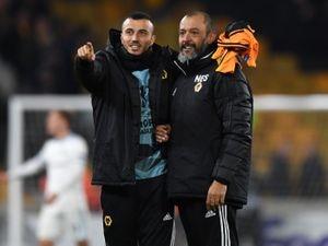 Romain Saiss of Wolverhampton Wanderers and Nuno Espirito Santo the head coach / manager of Wolverhampton Wanderers celebrate at full time.