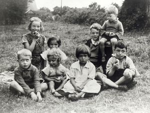 nostalgia pic. Wellington. 1935. Republication date 8/9/99. Changing generations remain the same  The more children change generation by generation, the more they seem the same, as this shot of Shropshire youngsters from 1935 shows. It was sent in by Don Houlston of Park Street, Wellington, after he saw our 1969 picture on August 9 of the road bridge over the disused British Rail line from Wellington to Crewe at Wrockwardine Road, Wellington.  My photo was taken in the paddock which was just on the right hand side of the road before the black bridge in Wrockwardine Road. This bridge used to be a meeting point for all of us in that area, the Bevans from Wrockwardine Road and the Jones children from Harpers Bank.  Back, from left: Joan, Florence and Jack Bevan, and Brian Houlston (sitting on a old Great Western Railway boundary sign which the children used as cricket stumps). Front, from left: Don Houlston, Marion and Roma Bevan, and Ken Scott.  My brother Brian and myself were both born in the black and white lodge on the right hand side of the road about 100 yards from the bridge. The lodge is still there,  added Mr Houlston. Library code: Wellington nostalgia 1999.