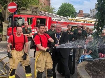 Newport firefighters help to water flowerbeds ahead of Britain in Bloom effort
