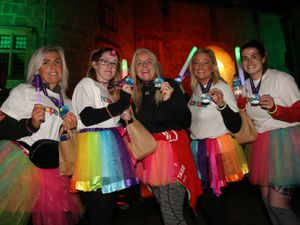 Participants showing off their medals at a previous dark run.