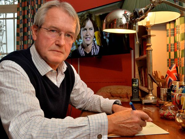 MP Owen Paterson, with his wife Rose picture behind him