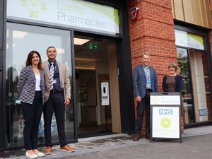 At the opening of the new home for Lunts Pharmacy are Ravi and Anj Nagra with Martin and Christine Lunt
