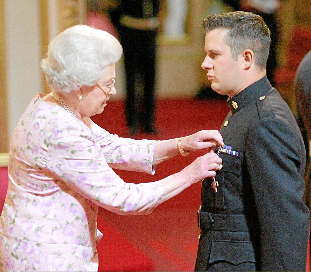 A proud moment as Kim Hughes is decorated with the George Cross by The Queen at Buckingham Palace on June 9, 2010.