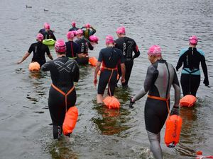 Some of the swimmers get into the mere