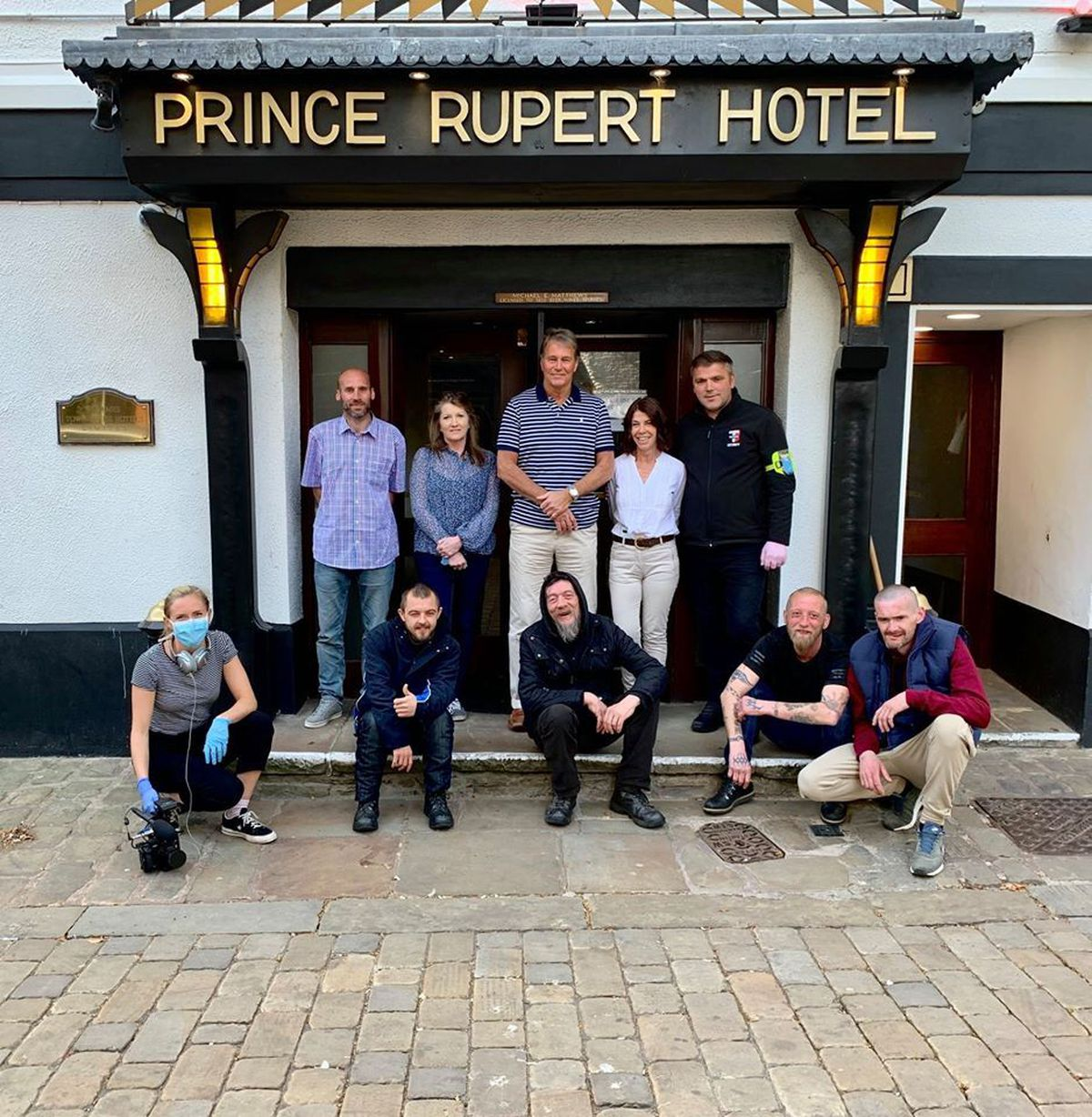 Mike Matthews, centre, with staff and homeless guests at the Prince Rupert Hotel