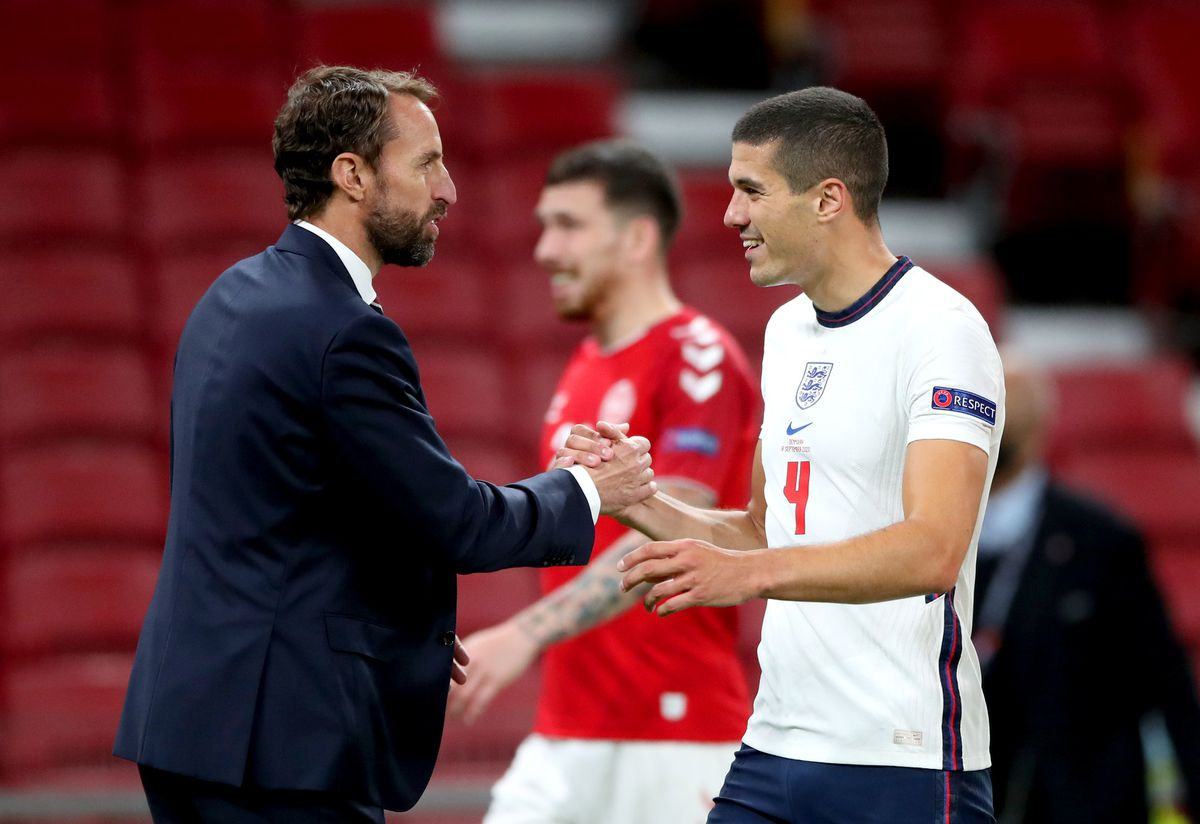 England manager Gareth Southgate shakes hands with Conor Coady (PA)