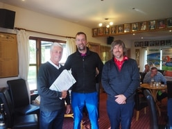 Golf day chips in with £2,000 for charity