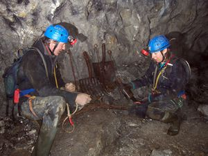 Andy and Emma Coyle examining mining artefacts discivered on the 40 yard level, Snailbeach Mine