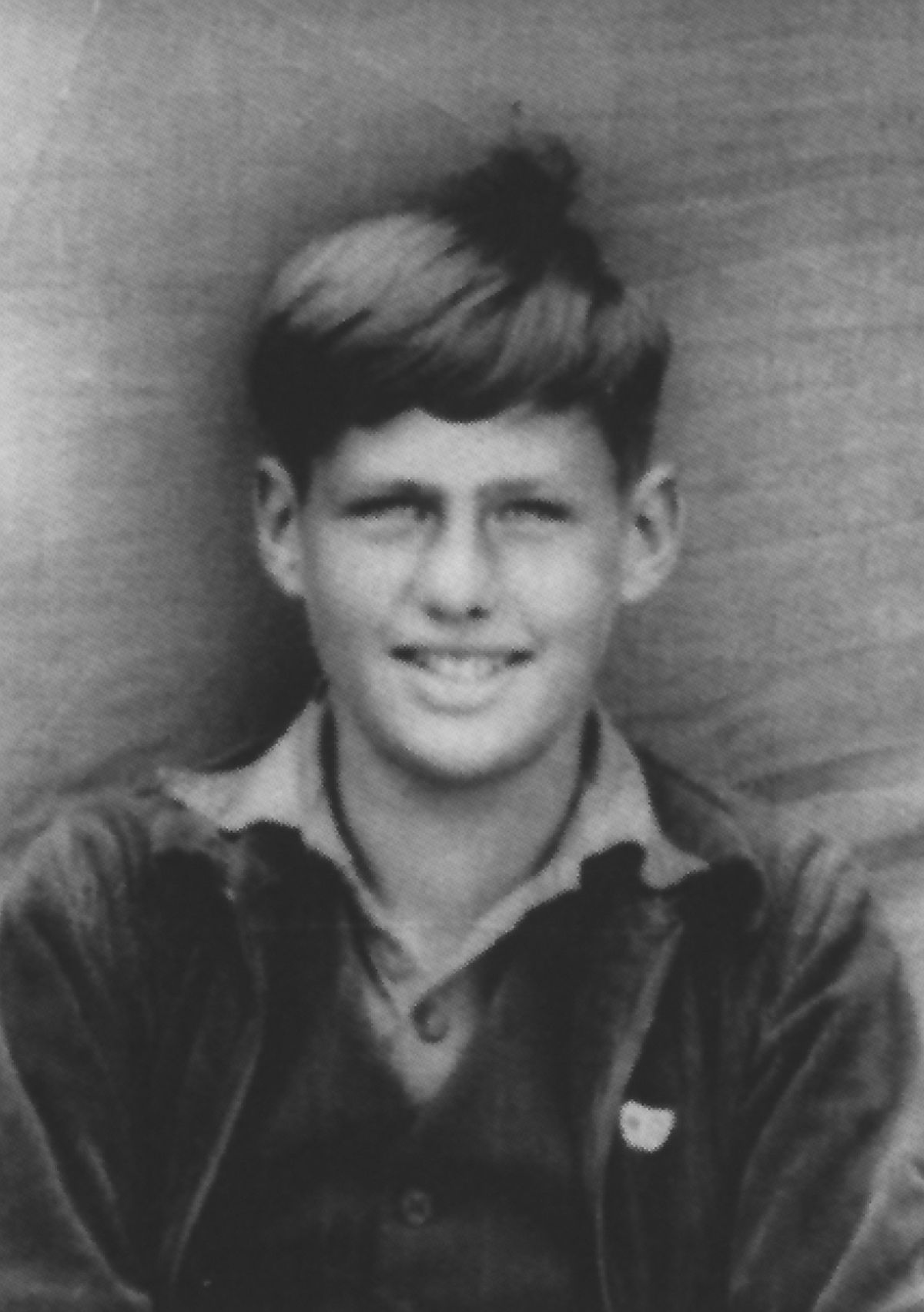 """Richard Harper as a schoolboy – """"Dapper"""" to his pals – at Croft Castle in about 1942 in recycled school uniform."""