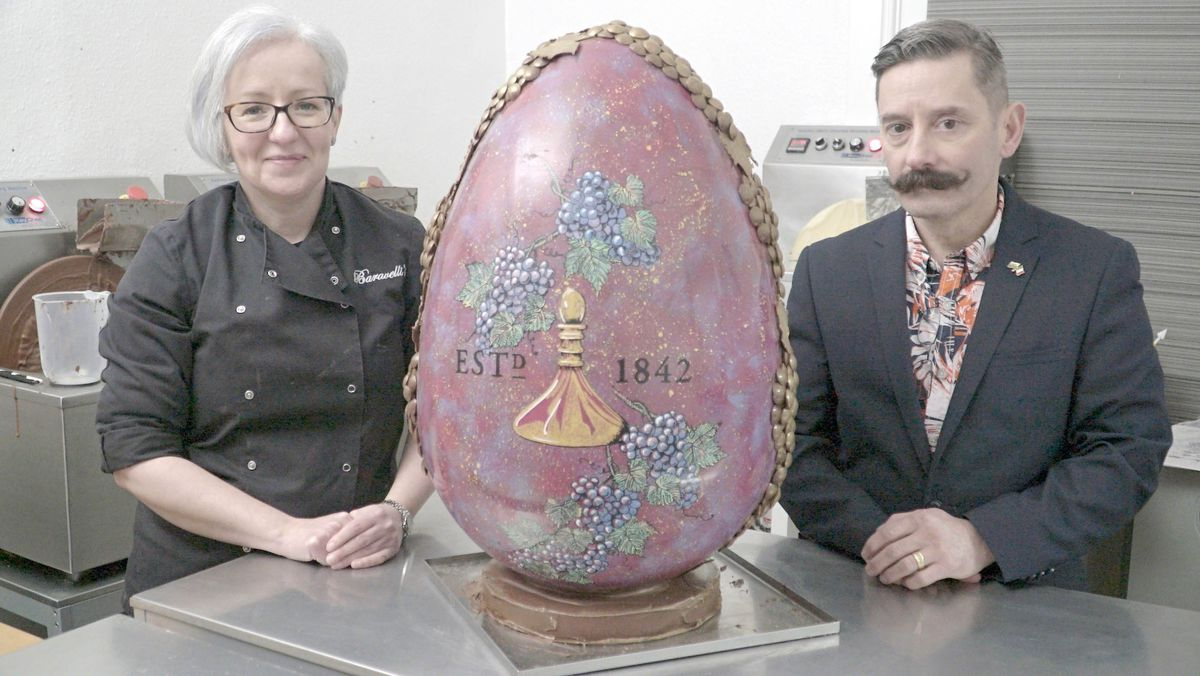 Emma and Mark Baravelli with the giant Shrewsbury egg, created to raise money for flood victims in the town