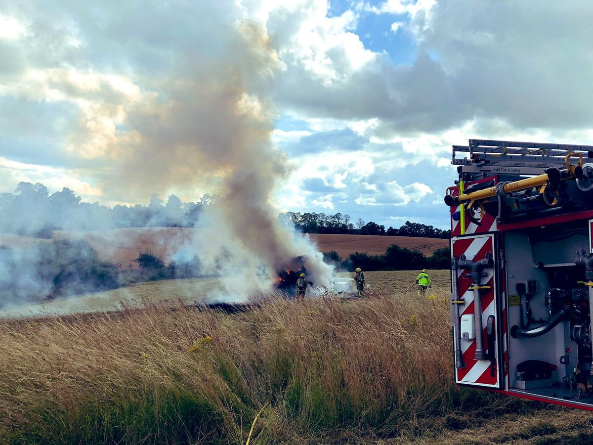 Firefighters douse the tractor blaze. Photo: @SFRS_cjackson