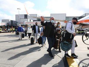Passengers prepare to board an easyJet flight to Faro, Portugal.