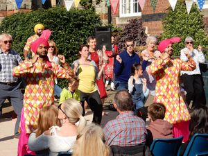 Bhangra dancers teach a few moves to the crowd at the multicultural fun day