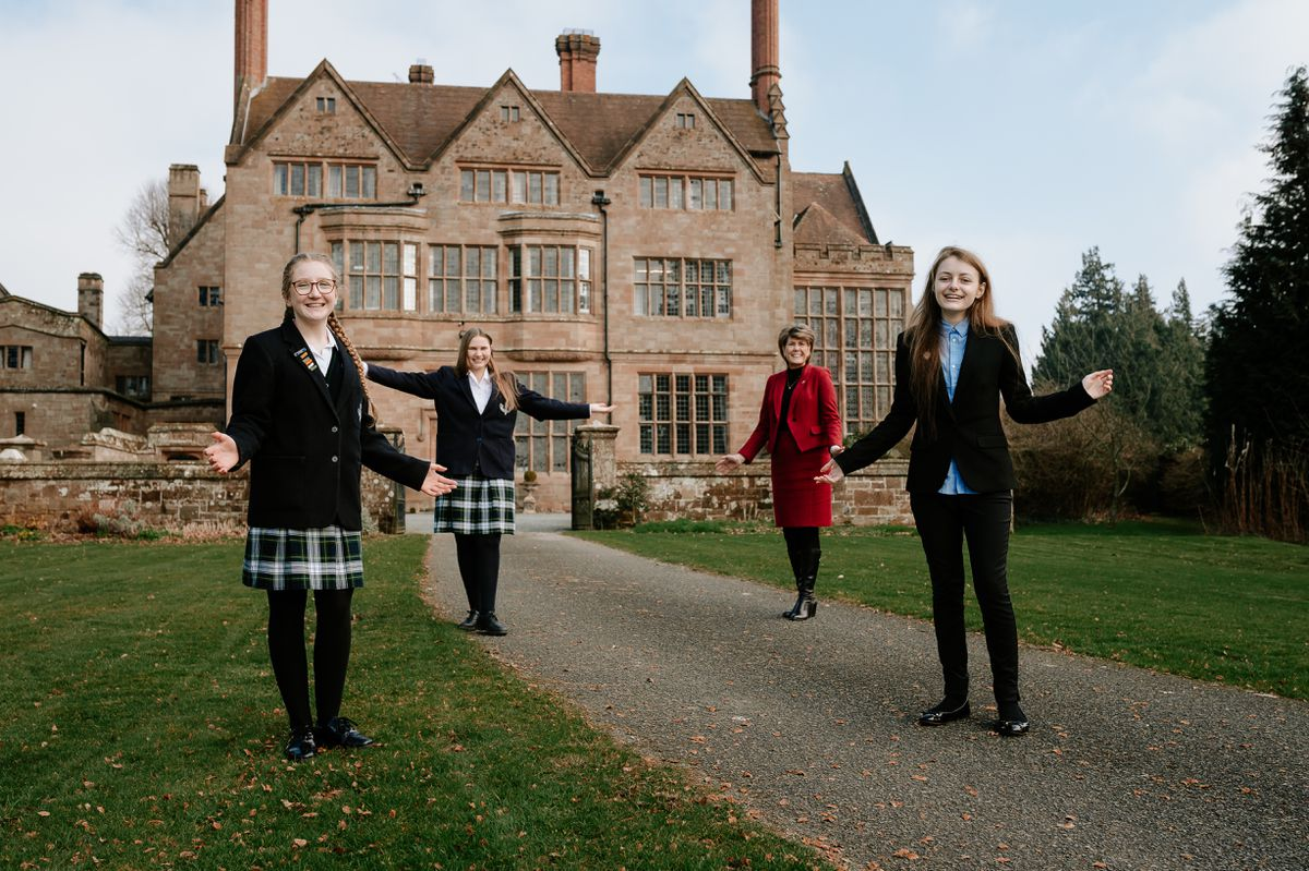 Headmistress Diane Browne (back right) with Adcote School students