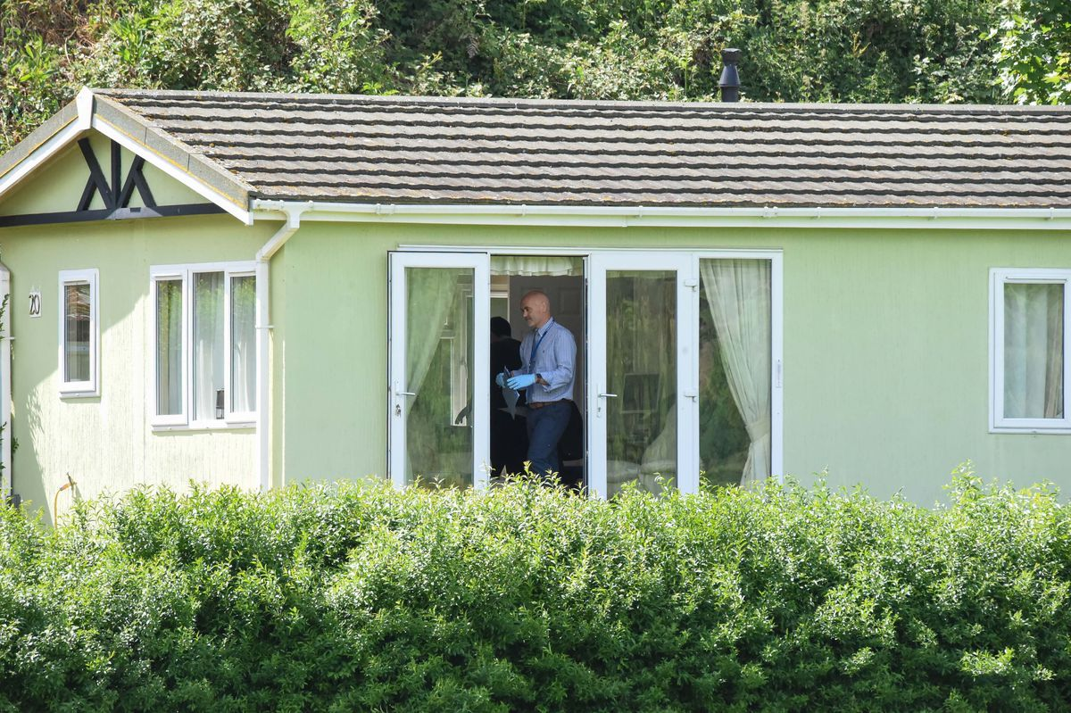Police searching a static caravan at the scene. Image: @SnapperSK