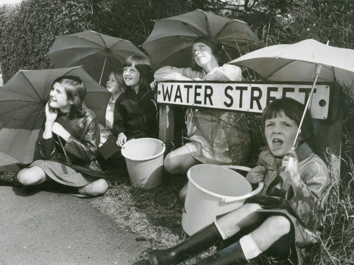 Young residents of Water Street, Chase Terrace, look hopefully for rain in 1976