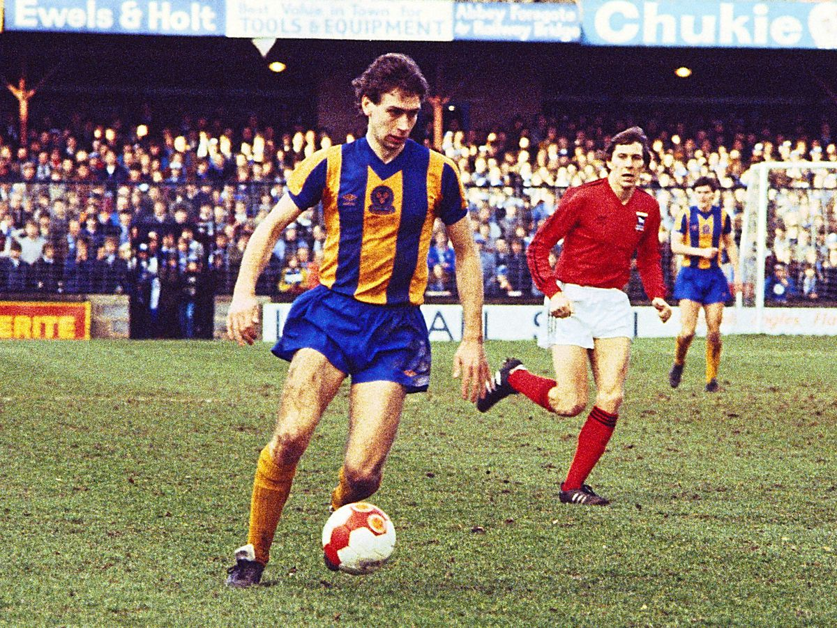Steve Biggins used to love playing at Gay Meadow – here he is in action against Ipswich with Arnold Muhren in the background in 1984 (AMA)