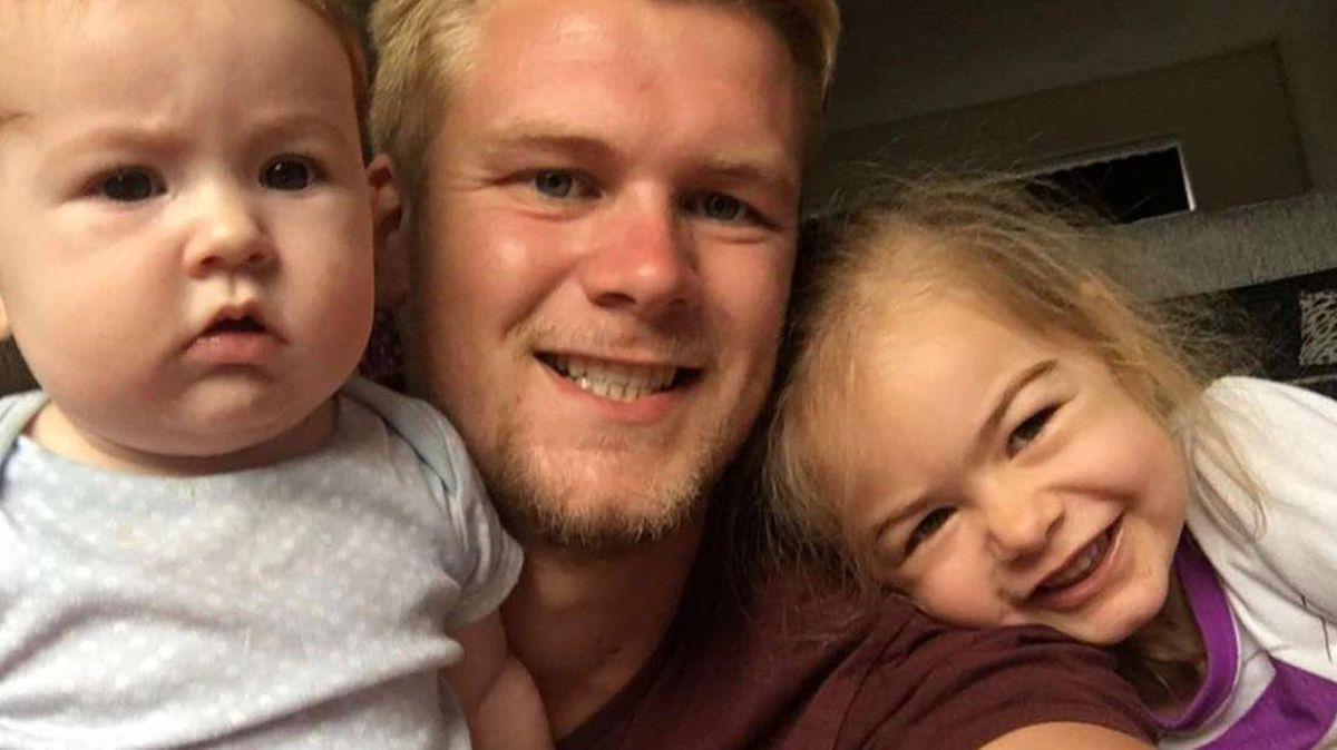 Rob Heywood with his daughters Harper-Jae, right, and Eden
