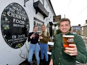 Ollie Jones is pictured with chef Anna Merricks and fellow staff member Jodie Betton